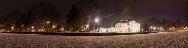 Cluj Napoca Central Park Casino and lake during winter. Wide panoramic view of Cluj Napoca Casino in Central Park on a cold winter night with snow and lights in Royalty Free Stock Images