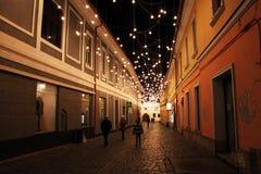 Cluj-Napoca by night, Transylvania, Romania. January 5, 2019: Beautiful night street scene taken at the Museum Square of Cluj-Napoca city, Transylvania, Romania royalty free stock image