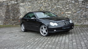 Cluj Napoca/Romania-April 7, 2017: Mercedes Benz W209 Coupe - year 2005, Elegance equipment, 19 inch wheels, profile view Royalty Free Stock Photo
