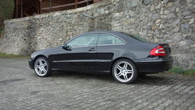 Cluj Napoca/Romania-April 7, 2017: Mercedes Benz W209 Coupe - year 2005, Elegance equipment, 19 inch wheels, profile view Royalty Free Stock Photos