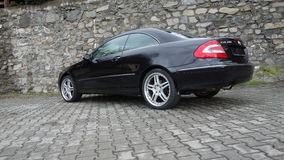 Cluj Napoca/Romania-April 7, 2017: Mercedes Benz W209 Coupe - year 2005, Elegance equipment, 19 inch wheels, profile view Royalty Free Stock Photography
