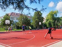 People play basketball on a public court outdoors royalty free stock image