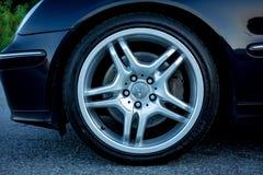 Nice sport elegant german car rim - big tires, ventilated brakes, chrome ornaments,. Cluj Napoca/Romania - August 27, 2017: Mercedes Benz C Class AMG alloy stock images