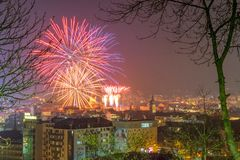 CLUJ-NAPOCA, ROMANIA - December 1, 2018: Fireworks in Cluj-Napoca, Romania viewed from Cetatuia Hill. Above aerial clouds environment horizontal kolozsvar night royalty free stock photography