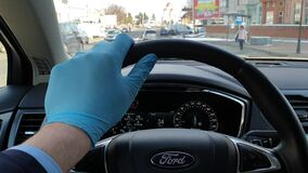 Drivers hand with surgical gloves