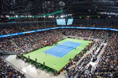 Indoor tennis court. CLUJ NAPOCA, ROMANIA - FEBRUARY 10, 2018: Romania playing tennis Canada during a Fed Cup match in the Polivalenta Hall indoor court. Crowd royalty free stock photography