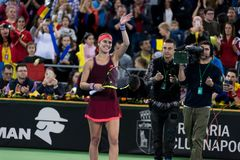 Woman tennis player celebrating the victory. CLUJ NAPOCA, ROMANIA - FEBRUARY 10, 2018: Romanian tennis player Sorana Cirstea celebrating victory against Carol Stock Images