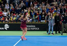 Woman tennis player celebrating the victory. CLUJ NAPOCA, ROMANIA - FEBRUARY 10, 2018: Romanian tennis player Sorana Cirstea celebrating victory against Carol Stock Photo