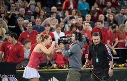 Tennis player signing an autograph. CLUJ NAPOCA, ROMANIA - FEBRUARY 11, 2018: Tennis player Gabriela Dabrowski from Canada signing an autograph on the camera Royalty Free Stock Photography