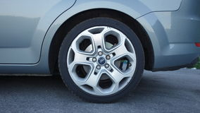Cluj Napoca/Romania -June 12, 2017 Rear left side alloy wheel with pressure sensor and run flat tire stock images