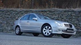 Cluj Napoca/Romania-March 31, 2017: Mercedes Benz W203 - year 2005, Avantgarde equipment, silver metallic paint near a rock wall p Royalty Free Stock Photo