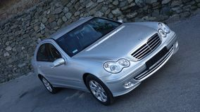 Cluj Napoca/Romania-March 31, 2017: Mercedes Benz W203 - year 2005, Avantgarde equipment, silver metallic paint near a rock wall p royalty free stock images