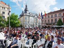 People watching the show. Cluj-Napoca, Romania - May 20, 2018: Huge crowd watching the show in the town center on the traditional Cluj Day festival Royalty Free Stock Image