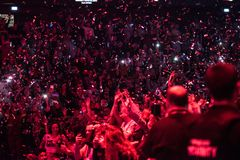 Confetti throwing over partying crowd. CLUJ NAPOCA, ROMANIA - NOVEMBER 19, 2017: Confetti throwing over partying and dancing crowd during the We Love Retro Disco Royalty Free Stock Image