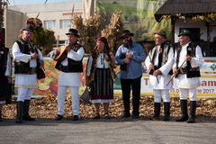 Band performing Romanian folk music in traditional costumes Royalty Free Stock Image