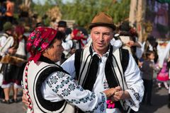 Romanian folk dancers dancing in traditional costumes Stock Photos