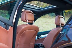 German luxurious limousine - brown leather interior, big panoramic sunroof, sport equipment royalty free stock photo