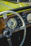 Cluj-Napoca, Romania - 24 September 2016 Klausenburg Retro Racing - Morgan Classic Retro Car steering wheel and wooden board detai. Morgan Classic Retro Car Royalty Free Stock Photos