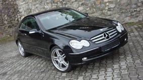 Cluj Napoca/Rumänien-April 7, 2017: Mercedes Benz W209 kupé - år 2005, elegansutrustning, 19 tum hjul, profilsikt Royaltyfria Foton