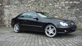 Cluj Napoca/Rumänien-April 7, 2017: Mercedes Benz W209 kupé - år 2005, elegansutrustning, 19 tum hjul, profilsikt Royaltyfria Bilder