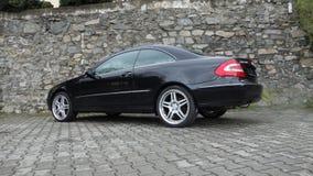 Cluj Napoca/Rumänien-April 7, 2017: Mercedes Benz W209 kupé - år 2005, elegansutrustning, 19 tum hjul, profilsikt Royaltyfri Bild