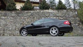 Cluj Napoca/Rumänien-April 7, 2017: Mercedes Benz W209 kupé - år 2005, elegansutrustning, 19 tum hjul, profilsikt Arkivbilder