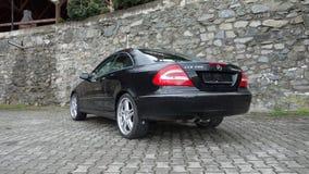 Cluj Napoca/Rumänien-April 7, 2017: Mercedes Benz W209 kupé - år 2005, elegansutrustning, 19 tum hjul, profilsikt Arkivfoto