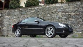 Cluj Napoca/Rumänien-April 7, 2017: Mercedes Benz W209 kupé - året 2005, elegansutrustning, svart metalliskt, rullar den 19 tum l Fotografering för Bildbyråer