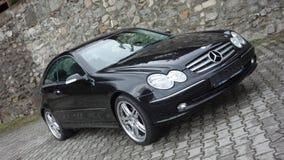 Cluj Napoca/Rumänien-April 7, 2017: Mercedes Benz W209 kupé - året 2005, elegansutrustning, svart metalliskt, rullar den 19 tum l Royaltyfria Bilder