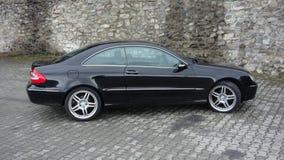 Cluj Napoca/Rumänien-April 7, 2017: Mercedes Benz W209 kupé - året 2005, elegansutrustning, svart metalliskt, rullar den 19 tum l Arkivbilder