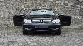 Cluj Napoca/Rumania 7 de abril de 2017: Cupé de Mercedes Benz W209 - año 2005, equipo de la elegancia, ruedas de la aleación de 1 Imágenes de archivo libres de regalías