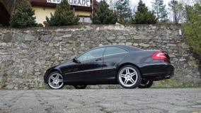 Cluj Napoca/Rumania 7 de abril de 2017: Cupé de Mercedes Benz W209 - año 2005, equipo de la elegancia, ruedas de 19 pulgadas, opi Imagenes de archivo