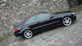Cluj Napoca/Rumania 7 de abril de 2017: Cupé de Mercedes Benz W209 - el año 2005, equipo de la elegancia, metálico negro, la alea Foto de archivo libre de regalías
