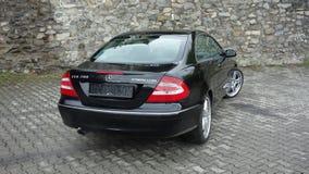 Cluj Napoca/Rumania 7 de abril de 2017: Cupé de Mercedes Benz W209 - el año 2005, equipo de la elegancia, metálico negro, la alea Fotografía de archivo