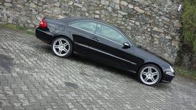 Cluj Napoca/Rumania 7 de abril de 2017: Cupé de Mercedes Benz W209 - el año 2005, equipo de la elegancia, metálico negro, la alea Fotos de archivo