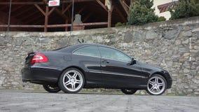 Cluj Napoca/Rumania 7 de abril de 2017: Cupé de Mercedes Benz W209 - el año 2005, equipo de la elegancia, metálico negro, la alea Imagenes de archivo