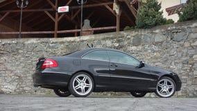 Cluj Napoca/Rumania 7 de abril de 2017: Cupé de Mercedes Benz W209 - el año 2005, equipo de la elegancia, metálico negro, la alea Imagen de archivo