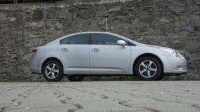 Cluj Napoca/Rumania 9 de mayo de 2017: Ejecutivo del sedán de Toyota Avensis - el año 2010, equipo de la cirugía estética, metáli Fotografía de archivo