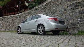 Cluj Napoca/Rumania 9 de mayo de 2017: Ejecutivo del sedán de Toyota Avensis - el año 2010, equipo de la cirugía estética, metáli Imágenes de archivo libres de regalías