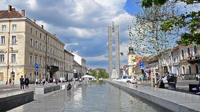 Cluj Napoca on a sunny day. Cluj-Napoca, Romania - 22 June 2015: Cluj Napoca Unirii Square and Eroilor Boulevard on a sunny summer day with people and cars stock video footage