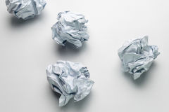 Clumped paper ball on paper. White background Stock Image