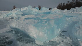 Clumps of blue ice on the snow. Beautiful winter Lake Baikal stock footage