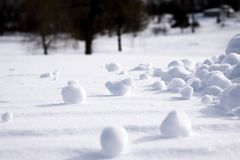 Clumps of Snow Scattered Over Land. Close view of several clumps of snow which have become scattered over a snow covered landscape stock photos