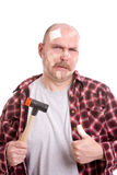 Clumsy handyman Royalty Free Stock Images