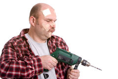 Clumsy handyman Stock Photo