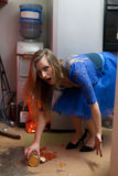Clumsy housewife Stock Images