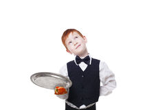 Clumsy inattentive little waiter drops pizza piece from tray. Clumsy little waiter drops tray with small pizza piece while dreaming. Food falling down. Redhead Royalty Free Stock Image