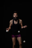 Clumsy juggler at the circus. Juggler dropping his balls at the circus. Clumsy / inattention concept Stock Photos