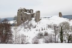 Clun casttle in snow. CLUN, UK - DECEMBER 12: The medieval castle of Clun stands on the hillside just outside the similarly named village after a heavy snowfall Stock Photo