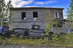 Clunker. In front of a abandoned hut Stock Photos